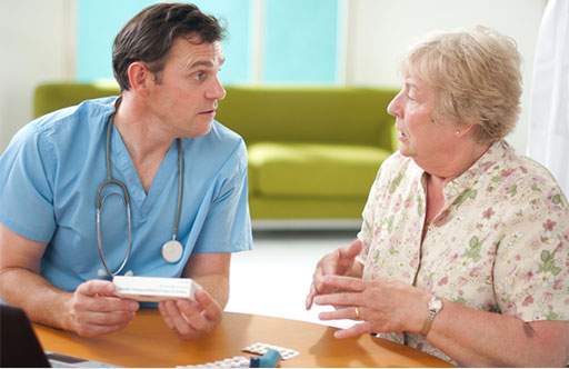 Photo of doctor and patient having a conversation